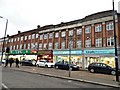TQ3597 : Shops on Hertford Road, Enfield Highway by David Howard