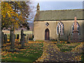 NO4480 : Gravestones at Lochlee Parish Church by Trevor Littlewood