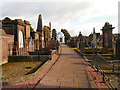 NX9775 : The Graveyard, St Michael's Church by David Dixon