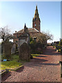 NX9775 : St Michael's Church and Churchyard by David Dixon