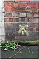 TQ2579 : Benchmark on the side of the closed post office, Kensington High Street by Roger Templeman