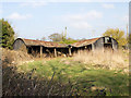 SP1059 : Dilapidated barn off School Road by David P Howard