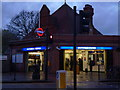 TQ2473 : Southfields Underground Station at dusk by R Sones