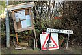 SJ3959 : Wonky Notice Board and Street Name Sign at Poulton by Jeff Buck