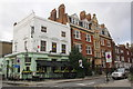 TQ2579 : Builders Arms and Hamston House, Kensington Court Place by Roger Templeman