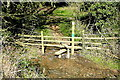 SP2929 : Stile over a stream by Graham Horn