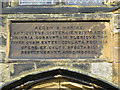 TA0489 : Latin plaque above St Mary's south door by John S Turner