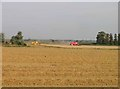 TL3780 : Combine harvesters harvesting by Andrew Tatlow