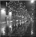 SJ8398 : Hardman Square Spinningfields in the rain by Steve  Fareham