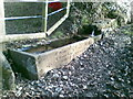 SJ9270 : Stone water trough with an inscription and a bench mark by John Harrison