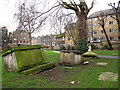 TQ3082 : Toppling tombs in St Andrew's Gardens by Stephen Craven