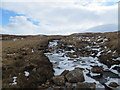 NN3449 : Iced up moorland burn on Rannoch Moor by John Ferguson
