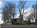 TL3966 : Longstanton: All Saints' Church and winter trees by John Sutton