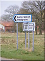 TM0877 : Roadsigns on Church Road by Adrian Cable