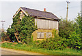 TF7016 : Derelict signalbox at former East Winch station, 1995 by Ben Brooksbank