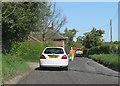 TG0539 : Rolling roadworks on Blakeney Road by Pauline Eccles