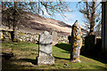 NH4591 : Gravestones on north side of Croick church by Trevor Littlewood
