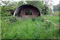 TL1641 : Derelict corrugated hut by Philip Jeffrey