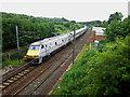 NT9561 : Train heading north on the East Coast Mainline through Burnmouth by Graham Robson
