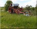 SP6836 : A very old Ransomes combine laid up by Michael Trolove
