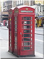 TQ3080 : London: red phone boxes, 84 Strand by Chris Downer