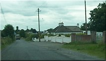 N0719 : Cottages on the northern outskirts of Cloghan by Eric Jones