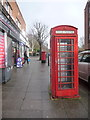 TQ2273 : Roehampton: red phone box in the High Street by Chris Downer