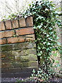 SJ6703 : OS benchmark - Ironbridge, Bridge Road wall by Richard Law