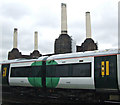 TQ2877 : Train passing Battersea power station by Thomas Nugent