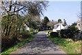 NO7094 : Minor road through Tilquhillie hamlet by Stanley Howe