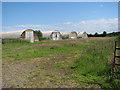 TG0814 : Nissen huts beside Stone Road by Evelyn Simak