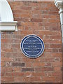 Photo of Button Gwinnett blue plaque