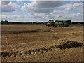 TL2867 : Harvest in progress by Mere Way by Hugh Venables
