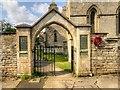 TF0008 : The War Memorial Arch, Great Casterton Church by David Dixon