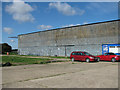 TM4687 : T2 aircraft hangar at the Beccles heliport site by Evelyn Simak