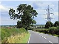 SK7455 : Power Lines Crossing the A617 near Micklebarrow Hill by David Dixon