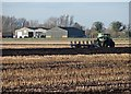 TL5468 : Winter ploughing in the Fens by John Sutton