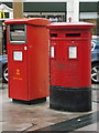 These postboxes have I think been moved here in the last six months from outside the old post office in East Street, just around the corner.  The one on the right is a standard double-aperture box dating from 1996 (the words ROYAL MAIL instead of POST OFFICE tell us that it is no older than 1994, but in fact this box is dated 1996 around the back).  The left-hand one is of a modern design and is specifically for franked items, which will not therefore need to be postmarked.
