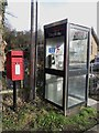 NU1530 : Post box and phone box in Lucker by Graham Robson
