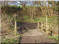 Dist:0.4km<br/>The footpath from Ockham Lane to Wisley Common crossing a drain and Hyde Lane.