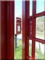 SY5096 : West Milton: the postbox from the phone box by Chris Downer