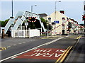 SS5099 : Level crossing barriers descend across the B4304, Llanelli by Jaggery
