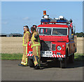 TM3295 : Firefighters on stand-by by Evelyn Simak