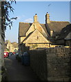 The building fronts onto the Marketplace; the alley in the foreground links through from the churchyard. The Old Woolhouse is described at http://list.historicengland.org.uk/resultsingle.aspx?uid=1340795&searchtype=mapsearch . Across the marketplace you can see the former Congregational Church http://list.historicengland.org.uk/resultsingle.aspx?uid=1155194&searchtype=mapsearch .