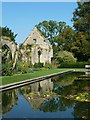 SP0327 : Sudeley Castle - Lily pond reflecting the Tithe Barn by Rob Farrow