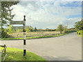 SJ6982 : Finger post directions at junction of Whitley Lane and Rowley Bank Lane, High Legh by Gary Rogers