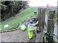 SP9113 : Repairing Startops Reservoir (6) Grouting Stonework at the Reservoir Spillway by Chris Reynolds