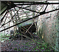TM3195 : View inside the ruined Floodlight Tractor and Trailer Shed by Evelyn Simak