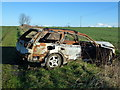 TL5075 : Torched car on Parson's Drove near Stretham, Cambridgeshire by Richard Humphrey