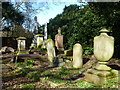 TF4510 : Eclectic group of memorial headstones - Wisbech General Cemetery by Richard Humphrey